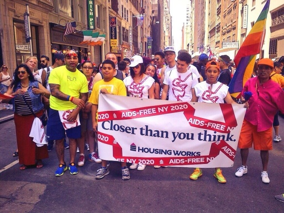 Housing Works staff, clients, volunteers, and allies, celebrating during NYC Gay Pride 2014.