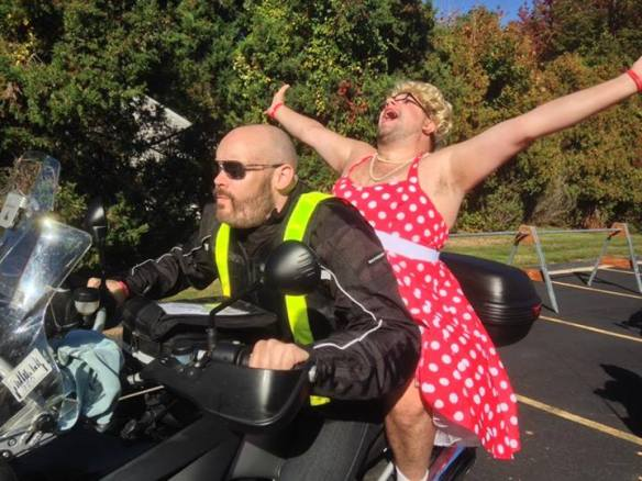 "Tom Dwyer, riding through new England in style in his self-described ""Tragic 'Ho"" outfit, Red Dress Day, Braking AIDS Ride, September 2013."